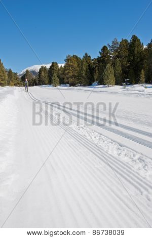 Man Skiing In The Snow During A Beautiful Day