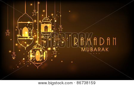 Hanging illuminated lanterns on shiny brown background, concept for Muslim community holy month of prayers, Ramadan Mubarak.