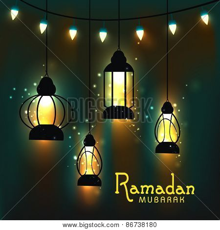 Hanging illuminate lanterns on shiny brown and green background for the celebration of Islamic holy month of prayers, Ramadan Mubarak.