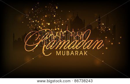 Stylish golden text Ramadan Mubarak on shiny brown background for Islamic holy month of prayers.