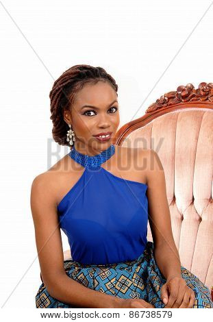 Portrait Of African Woman In Armchair.