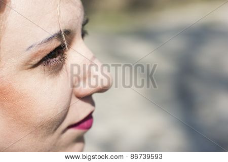 Young Curly Blond Woman Serious