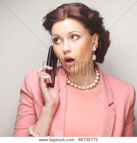 young funny businesswoman with mobile