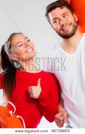 Happy Lifeguard Couple With Equipment