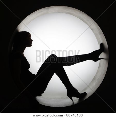stylish black silhouette beautiful woman in circle