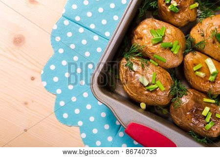 baked potatoes with onion in tray