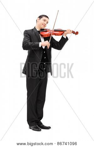 Full length portrait of a elegant musician playing an acoustic violin isolated on white background