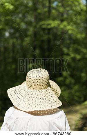 woman with hat in the park