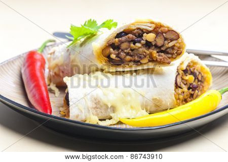 burrito filled with beef minced meat and beans baked with gouda cheese
