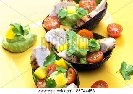 avocado filled with chicken salad and avocado dip