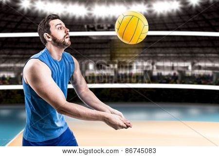 Volleyball player on blue uniform on volleyball court