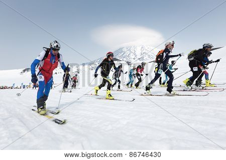 Mass Start Race, Ski Mountaineers Climb On Skis On Mountain. Team Race Ski Mountaineering. Kamchatka