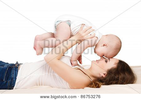 Young mother playing with her little son.