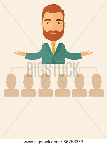 An executive good looking and happy  Caucasian with beard explaining and presenting a business marketing plans to his employees in front of him inside the training room. Planning a business concept.