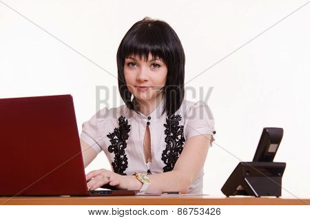 Portrait Of A Call-center Employee In Front The Monitor