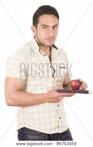 young hispanic male teacher holding red apple