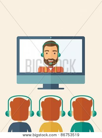 A happy Caucasian businessman in a monitor with beard giving a business presentation with three men in front of him wearing their headphones . Business presentation concept. A contemporary style