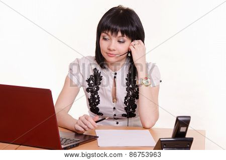 Girl Call-center Employee At The Desk