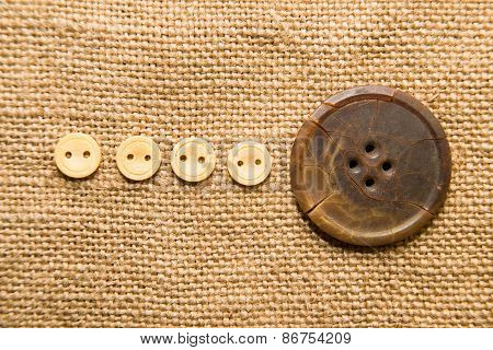 A Lot Of Old Buttons  On The Old Cloth