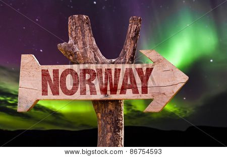 Norway wooden sign with northern lights background