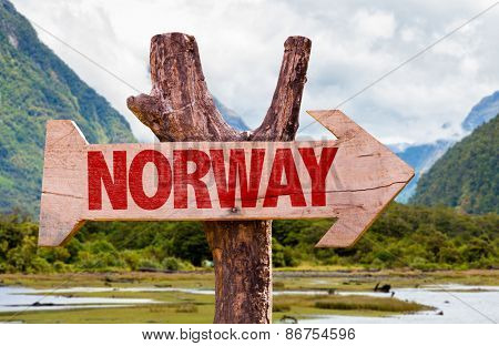 Norway wooden sign with mountains background