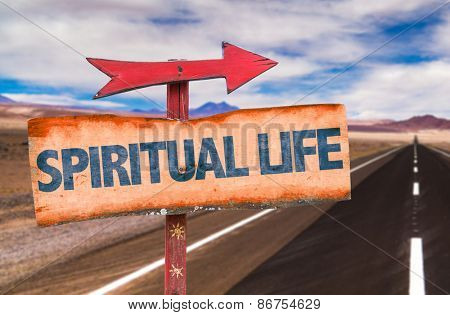 Spiritual Life sign with road background