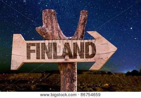 Finland wooden sign with a beautiful night