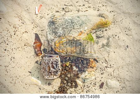 Garbage In Shallow Water, Beach Polluted By People.