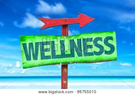 Wellness sign with beach background