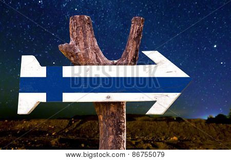 Finland flag wooden sign with a beautiful night
