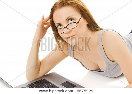 Attractive girl with blue eyes and laptop