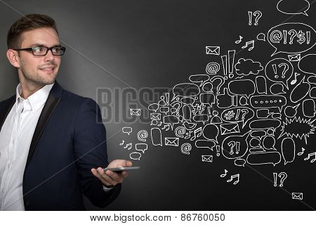Businessman With A Cellphone On His Hand. Buble Or Speech Text