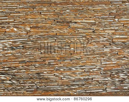 Background Of Old Rusty Drill Bits Of Various Sizes.