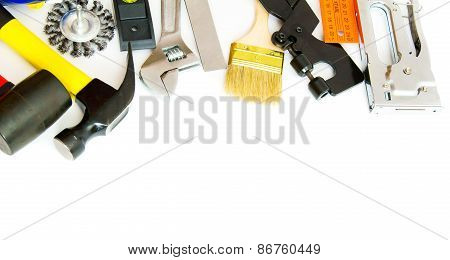 Many working tools - hammer, ruler, spanner and others on white background.