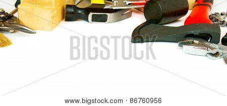 Many working tools - axe, hammer, scissors and others on white background.