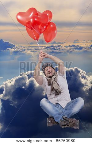 Young man flying on balloons with cloud sky in background