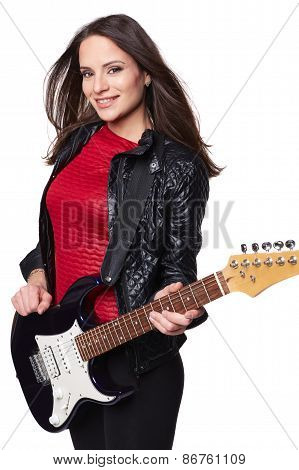 Sexy girl with electric guitar against white background. Isolated