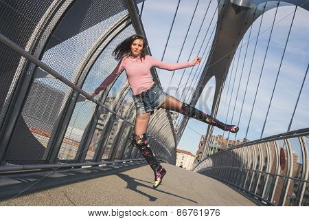 Beautiful Young Brunette Jumping On A Bridge