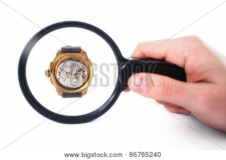 Looking At Clock Through Loupe