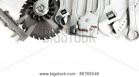 Metalwork. Stapler, saw, wrench and others tools on white background.