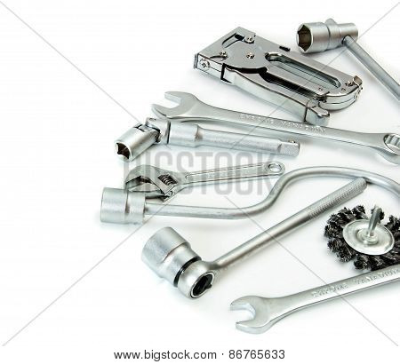 Metalwork. Spanner, stapler and others tools on white background.