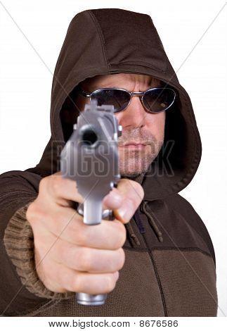 man in a hood with gun