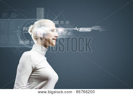 Young woman in white against media background wearing headphones