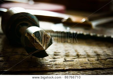 old working tools  on a wooden background.