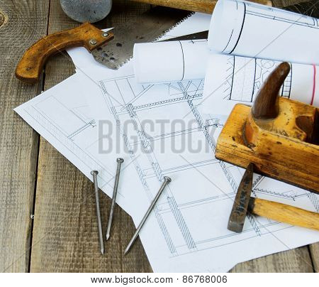 Joiner's works. Drawings for building and working tools on old wooden background.