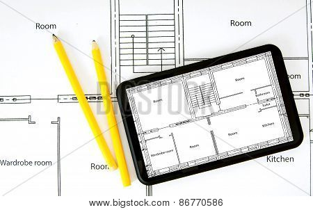 Tablet, drawings and working tools.