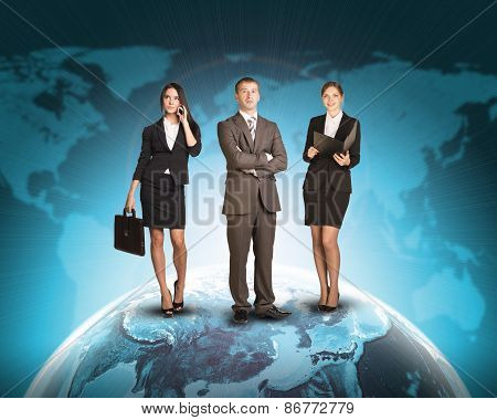 Business people standing on Earth surface