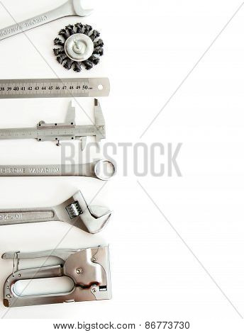 Metalwork. Ruler, caliper and others tools on white background.