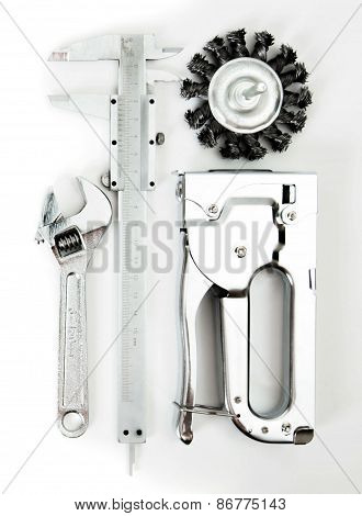 Metalwork. Wrench, caliper and others tools on white background.