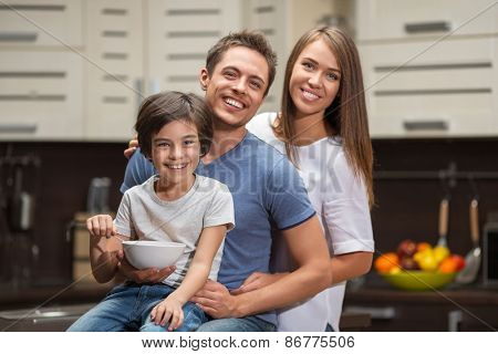Families with a child in the kitchen
